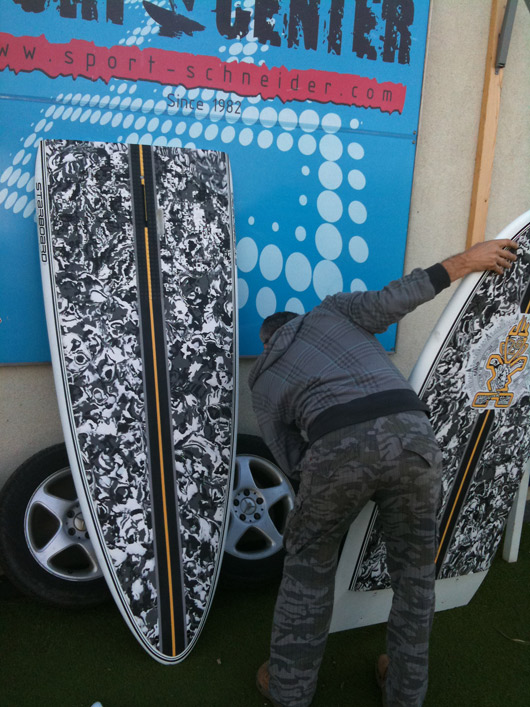 "Herbert with the splitted SUP Two Piece 11'2"" x 30"" Camo Black."