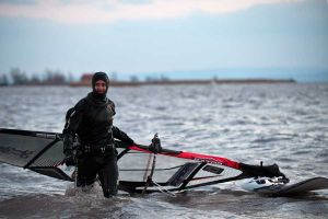 Full dry suit makes sailing possible.
